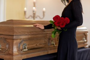 Burial,,People,And,Mourning,Concept,-,Unhappy,Woman,With,Red
